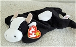 Ty, Inc. Daisy the retired black and white calf (baby milk cow) beanie baby plush from 1994-1998 (this one is from 1997-1998), No. 4006; her day of birth is May 10, 1994. Daisy was introduced on June 24, 1994, and retired on September 15, 1998. The verse on Daisy's tag is: 'Daisy drinks milk each night, So her coat is shiny and bright, Milk is good for your hair and skin, What a way for your day to begin!'  Mint with tag old stock is approximately 7 to 8 inches in size. Expand this listing to view both photographs.