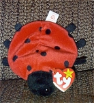The Ty, Inc. Beanie Baby plush, Lucky the red lady bug with 11 printed spots has a birthday of May 1, 1995. Lucky was introduced on February 27, 1995, and retired on May 1, 1998. Lucky is 7 to 8 inches in size. The verse on Lucky's tag is: 