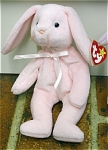 Ty, Inc. Pink Hoppity standing (and can sit) girl Bunny Rabbit beanie baby plush, No. 4117, is approximately 7-8 inches tall and has a pink ribbon around the neck. Her birthday is April 3, 1995. Hoppity was introduced on January 1, 1997, and retired on May 1, 1998. The verse on Hoppity's tag is: 