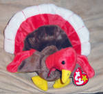 Ty Gobbles the colorful red, brown, yellow, and white baby turkey beanie baby, No. 4034 is approximately  8 inches in size. Her day of birth is November 26, 1996. Gobbles was introduced on October 1, 1997, and retired on March 31, 1999. Her tag says:  