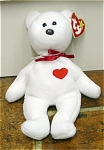 Ty, Inc. from 1995-1998. Valentino, No. 4058,  the White Bear with a Red Heart beanie baby plush. This beanie teddy bear's day of birth is February 14, 1994, Valentine's Day. This is a great Valentine's Day bear. He was introduced January 7, 1995 and retired December 31, 1998. This one has a 4th Generation tag. Valentino is approximately 7 to 8 inches in size. His verse is: 