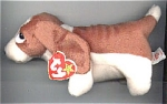 The Ty, Inc. Beanie Baby plush, Tracker the light Brown and White Bassett Hound Puppy, No.  4198 is mint with tag and looks real. This basset hound's birthday is June 5, 1997. Tracker was introduced on May 30, 1997, and retired on November 26, 1999.  
