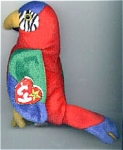 The Ty, Inc. Beanie Baby plush, Jabber, No. 4197, is a colorful red with green, blue, and yellow parrot that is mint with tag. Jabber's day of birth is October 10, 1997. Jabber was introduced on May 30, 1998, and retired on December 23, 1999. This beanie baby is 8 inches in size. The verse on Jabber's tag says: 