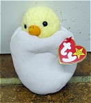 Ty Eggbert Beanie Baby plush, the Yellow Baby Chicken hatching from an egg, No. 4232. Eggbert's birthday is April 10, 1998. Eggbert was introduced January 1, 1999, and retired July 28, 1999. This little chick is mint with tag and has not been exposed to smoke or unpleasant odors. Eggbert's verse is: 