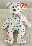 Ty 2K Teddy Bear, the retired white with multi-colors of confetti print plush beanie baby's day of birth is January 1, 2000.  Ty 2K was introduced August 31, 1999, and retired on December 23, 1999.  Ty 2K reminds us of the anticipation of disaster expected with the turn of the millennium, but fortunately only the partying occurred without the anticipated computer glitches. Ty 2K's verse on his tag is as follows: 
