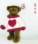 Ty Casanova, No. 6073, Attic Treasure Small is 7-8 inches tall standing plush brown teddy bear has jointed arms, legs, and head. Casanova is wearing a knitted white sweater with red knitted edging and a large red heart, was introduced January 1, 1998, and retired February 28, 1999. Casanova has black stick-on bead eyes, a black embroidered nose and mouth. Casanova's verse is: 'You hold The Key to My Heart.' Retired, mint, like new, with tag. Expand listing to view both photographs.