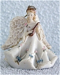 1994 United Design Angels Collection Heavenly Harmony cold-cask-type petite bisque 1.5 inch angel figurine ornament playing a mandolin or lute. This blonde angel has full wings, and is dressed in a white gown with tiny pink rosebuds and blue bows trim. When she is not being used as an ornament; she also be displayed as a figurine standing alone on her base. This very beautiful angel has detailed carving, and was made in the U.S.A.  New, mint-in-the-box. Expand listing to view both photographs.