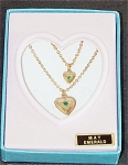 Click here to enlarge image and see more about item VOG0735B: Vogue Ginny Doll and Girl May Emerald Necklaces 1993