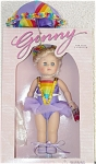 Vogue 8 inch hard vinyl discontinued modern Ginny Tightrope Walker doll from the 1998 Ginny's Little Circus Collection. She has blonde double ponytails which are put up with colorful bands, and blue moving eyes. She wearomg in a colorful lavender circus performer ensemble with gold and multicolored bands trim and purple cloth tied shoes. Accessories include a colorful matching cloth and metal umbrella which is open to help her keep her balance, a metal signature 'Ginny' stand, and doll-sized comb and brush.  Near mint-in-the-box old stock; box may show shelf wear. Expand listing to view both photographs.