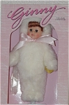 Vogue Ginny Bunny doll, from the 1998 Special Occasions collection is a red headed 8 inch doll with moving brown eyes. She is wearing a white fluffy bunny costume with a large pink bow. This Ginny doll is perfect for Easter. This discontinued doll is new and mint-in-the-box, and includes a doll-sized comb and brush.