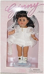 Vogue 1998 Ginny Hispanic Communion doll from Ginny Celebrates collection, is an 8 inch hard vinyl doll with lovely tan skin, long dark brunette hair, and moving brown eyes. Her ensemble includes a lacy white dress, a lacy white veil, a gold cross, white socks, and white center-snap shoes. This doll includes a metal 'Ginny' stand and doll-sized comb and brush. Discontinued special occasion doll is new and mint-in-the-box.