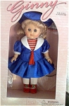 1999 Vogue Ginny Journeys to Paris from the Ginny Travels Collection, an 8 inch hard vinyl modern Ginny doll, has blonde hair and blue moving eyes. France has the same national colors as the U.S.A. She is wearing a red, white, and blue sailor-type dress with matching tam, and red center-snap shoes. A doll-sized comb and brush and plastic heart-shaped 'Ginny' stand are included. This retired doll is new, and mint-in-the-box.