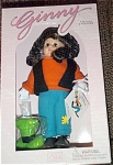 Vogue Ginny Goes Goofy, retired limited edition of 500, from 2000 Walt Disney World Teddy and Doll Convention in Florida. This 8 inch tall, hard vinyl modern Ginny doll has brunette braids and moving brown eyes. She is dressed like the Disney Character, Goofy in teal felt pants with yellow patch, an orange shirt, a black vest, a green felt 'Goofy' hat with black band, white 'Goofy' gloves, and big brown shoes like Goofy's shoes. Retired, new and mint-in-the-box with doll-sized comb and brush.