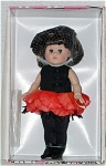 Vogue 2001 Oriental Poppy Ginny doll from the Botanical Babies collection that represented flowers. This modern Ginny doll is 8 inches tall, has short brunette hair with a large black bow, and moving brown eyes. Her flower costume includes a black on a hot pinkish orange pedals felt dress and black tights so that she looks like a flower. This retired doll is new and mint-in-the-box, with a doll-sized comb and brush.