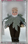 Vogue 2001 Dandelion modern Ginny doll from the Botanical Babies collection that represent flowers. This  Ginny doll is 8 inches tall, has blonde hair and moving blue eyes. Her wispy flower costume includes a dark olive-green felt bodysuit with a green leaf collar, and white headdress that is wispy like a dandelion. Retired doll is new and mint-in-the-box, with a doll-sized comb and brush.