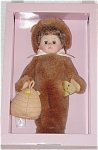 Vogue 2001 Beary Cute Ginny Doll from the 'It's Just Ginny' Collection is an 8 inch hard vinyl doll with medium brown hair, moving brown eyes, and a nose painted brown. Her teddy bear ensemble includes a furry brown bear suit, and she is holding a beehive. Retired doll is new and mint-in-the-box with doll-sized comb and brush.