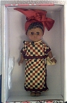 Vogue 2002 International modern Ginny from Africa doll is 8 inch hard vinyl doll has dark skin, dark eyes, short black hair and bangs. Her traditional African costume consists of  a red turban with gold moon earrings attached, a long red, black, and beige checked wrap around skirt with a matching blouse, wooden beads, and bare feet. This discontinued doll is new and mint-in-the-box with a doll-sized comb and brush.