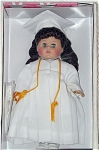 Vogue 2002 Graduation Brunette Modern Ginny doll from the Ginny Celebrates collection is a hard vinyl doll that is 8 inches tall with moving blue eyes. For her special day, she is wearing a white dress under a white graduation gown with gold tassels on the hood, a white graduation cap, white tights, and white center-snap shoes. A miniature diploma and doll comb and brush are included. Retired doll is new old stock and mint-in-the-box.