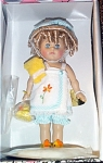 Vogue 2003 Fun with Ginny Bubble Bath, No. 3HP276, is an 8 inch hard vinyl Ginny doll with blonde ringlet curls and moving blue eyes. Her bath ensemble consists of a terry cloth bath jacket with embroidered flower and aqua stripe trim, aqua striped bloomers, yellow towel, with duck bath toy and yellow duck slippers. Wow! what an adorable Ginny! Retired, pre-owned, but looks new, mint-in-the-box with doll-sized comb and brush.