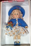 2003 Vogue Thank You modern Ginny, No. 3HP263, is a blonde 8 inch doll with blue moving eyes from the collection of Special Occasions dolls. Her ensemble includes a floral print dress, blue  embroidered felt jacket, and matching hat, blue center-snap shoes. She is holding bouquet of flowers. What a sweet doll! Mint-in-the-box old stock; includes a doll-sized comb and brush.