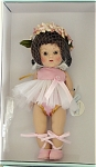 Vogue 2004 Vintage-Reproduction Ballerina, 7.5 inch hard plastic strung Ginny doll has a brunette flip wig with bangs topped by an ivory, peach, pink, and green silk flower and leaf floral wreath and moving brown eyes, and painted lashes. Her ballet costume consists of a pink tutu with gold braid trim and white net over skirt, sheer hose, and pink ballet shoes. A pink button and ribbon is at her waist. This doll is from a limited edition of 1,000. She has wonderful coloring and looks like the best of the dolls from 1952 and 1953. New, mint-in-the-box, and includes her certificate. Expand listing to view both photographs.