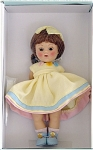 Vogue 2004 Vintage Reproduction Pat 7.5 inch hard plastic strung Ginny doll has an auburn flip wig with large yellow hair bow and moving brown eyes, and painted lashes. She is wearing a yellow cotton pique dress with blue and pink bands at the hemline and pink, yellow, and blue cloth flowers at her neckline, matching yellow panties, pink socks, and blue center-snap shoes, much like the vintage outfit. Limited edition of 1,000. She has wonderful coloring and looks like the best of the dolls produced in 1952 and 1953. Wow! New, mint-in-the-box, and includes her certificate. Expand listing to view both photographs.