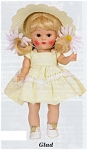 Vogue 2004 Vintage Reproduction Glad 7.5 inch hard plastic strung Ginny doll has a yellow-blonde flip wig with bangs, moving brown eyes, and painted lashes. She is wearing a two-tier yellow with white print dress with lace edging on the second tier, yellow slip and panties, sheer hose, white center-snap shoes, and a white open-weave hat with two large yellow and white daisies. Limited edition of 1,000. A doll-sized comb and brush is included. She has wonderful coloring and looks like the best of the dolls produced in 1952 and 1953. Retired, new, mint-in-the-box, and includes her certificate. Expand listing to view both photographs.