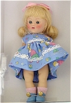 Vogue 2004 Vintage Reproduction Playtime 7.5 inch hard plastic strung Ginny doll. She has a pale blonde flip wig with bangs and large pink bow, moving blue eyes, and painted lashes. Her blue dress has a boy, girl, and pets at play print, and lace trim at hemline, waist, sleeve-line, and neckline. Accessories include matching panties, pink socks, and blue center-snap shoes. Her outfit is based on the costumes of the vintage Ginnys of the 1950s. She has wonderful coloring and looks like the best of the dolls produced in 1952 and 1953. Limited edition of 1,000. Mnt-in-the-box old stock includes her certificate. Expand listing to view both photographs.