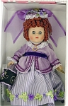 Vogue 2005 Victorian 1870 Lavender Ginny doll. This 8 inch hard vinyl Ginny doll has red ringlet curls and moving blue eyes. Her Victorian-style costume consists of a lavender striped skirt with lavender and green floral trim, lavender velveteen bodice, black shoes, and floral hat and muff. This is an exceptionally pretty doll! Retired limited edition doll is new, and mint-in-the-box old stock with doll-sized comb and brush.
