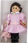 Vogue 2005 Rebecca of Sunnybrook Farm Ginny Doll from the Children's Literature and Nursery Rhymes Collection. This 8 inch hard vinyl Ginny doll has rooted hair styled in brunette braids with two pink ribbons and moving brown eyes. She is wearing a pink and white check gingham drop-waist dress and is carrying a matching parasol,  black tights, and high-top black shoes.  Other accessories include her comb and brush. Retired, new, mint-in-the-box. Expand listing to view the photograph and catalog picture.