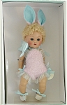 Vogue 2005 Crib Crowd Pink Bunny doll is a blonde 7 inch hard vinyl vintage reproduction Ginny baby doll who sits with bent knees has a blonde lamb's wool wig, and moving blue eyes with painted lashes. Her bunny rabbit costume consists of a pink flocked playsuit with blue edging and blue bow, pink and blue bunny ears, and white shoes with blue laces. She is perfect for Easter or other Spring  occasions. From limited edition of 1,000. Vogue is not currently making any Crib Crowd reproduction dolls. Retired doll is new and mint-in-the-box with certificate, comb and brush. Expand listing to view both photographs and the catalog picture.