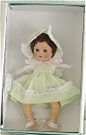Vogue 2005 Crib Crowd Baby Love Green, 7 inch hard vinyl vintage reproduction Ginny baby doll with brown lamb's wool wig, and moving blue eyes with painted lashes. Her outfit includes a green dress, matching green bloomers and a green bonnet with white lace trim, and pink cloth shoes. Discontinued limited edition of 1,000. There are currently no Crib Crowd dolls in production. Discontinued, new, and mint-in-the-box with certificate, includes a doll-sized comb, and brush. Expand listing to view both photographs.