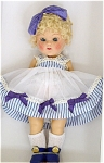 Vogue 2005 vintage reproduction 7.5 inch Ginny Doll, Tiny Miss 'June', from retied limited Edition of 1,000. She has a pale blonde poodle-cut wig with large blue hair bow and moving blue eyes with painted lashes. She is wearing a white organdy dress with blue pinstriped bodice and hem band with blue bows, white socks, and blue center-snap shoes as the 1952 Tiny Miss Series 'June' No. 41 was dressed. New, mint-in-the-box with certificate and doll-sized comb and brush.
