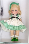 Vogue 2005 7.5 inch vintage Hope reproduction hard plastic Ginny doll, Hope with blonde flip side-part wig and moving blue eyes with painted lashes. SHer ensemble includes a green gingham trimmed cotton school dress with suspenders, a black bow at her neck, black belt and purse, white socks, and black center-snap shoes. This doll is based on a very popular style in the 1953 Kindergarten School Series, 'Hope' No. 27. Limited Edition 1,000. Mint-in-the-box old stock with certificate.