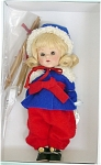 2005 Vintage Reproduction 7.5 inch hard plastic Ginny Skier with blonde flip hair with bangs and moving brown eyes with painted lashes. She is wearing a royal blue felt and red flannel ski outfit that has a white fur-like trim and black shoes. Includes her skis and poles. This doll's outfit is based on the 1952 Sports Series, 'Skier.' Retired limited edition of 1,000.  New, mint-in-the-box with Certificate, includes doll-sized comb and brush.