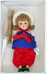 2005 Vintage Reproduction 7.5 inch hard plastic Ginny Skier doll with auburn flip hair with bangs and moving brown eyes with painted lashes. She is dressed in a royal blue felt and red flannel ski ensemble that has white fur-like trim and black shoes. She is carrying her skis and poles. This doll is based on the 1952 Sports Series, 'Skier.' Retired limited edition of 1,000.  Mint-in-the-box old stock with certificate, and includes a doll-sized comb and brush.