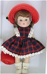 Vogue 2005 Vintage Reproduction 7.5 inch hard plastic Ginny Doll, Merry Moppets is from a limited edition of 1,000. She has an auburn flip wig with bangs and moving blue eyes with painted lashes. Her 1950s-inspired outfit includes a red and blue plaid dress with a coordinating red straw hat with flowers and red straw purse, white socks, and white center-snap shoes. This outfit is inspired by Merry Moppets Series of 1956. Includes a doll-sized comb and brush. retired, new, mint-in-the-box. Expand listing to view both the photograph and the catalog picture.