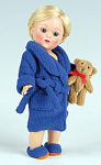 Vogue 2008 7.5 inch Vintage Reproduction Boy version of Ginny No. 8VCP22 Bed Time doll Clothing Pack includes a dark blue bathrobe with blue slippers, and an adorable jointed brown teddy bear with a red bow. This doll outfit fits the slightly smaller vintage version of the Ginny doll, and may be snug on the 8 inch modern Ginny doll. This doll outfit is new and mint in its sealed package. Less expensive insured first class mail shipping is available by request in the comments section of the order page if only a single outfit is ordered. The price is for the outfit only and does not include the doll modeling it.
