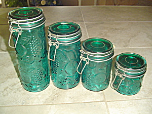 Set of 4 Green Glass Canisters with Hinges/Seals Fruit Design (Image1)