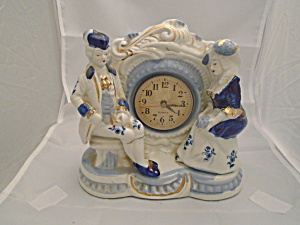 Colonial Couple Blue And White Quartz Porcelain Clock