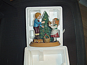 Avon Keeping The Christmas Tradition Figurine