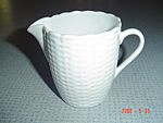 Click here to enlarge image and see more about item 1225: Tienshan White Wicker Creamer