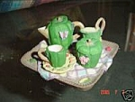 Click here to enlarge image and see more about item 1454: Miniature Resin Green Pepper Tea Set