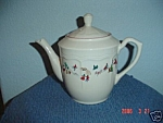 Click here to enlarge image and see more about item 575: Farberware White Christmas Tea Pot