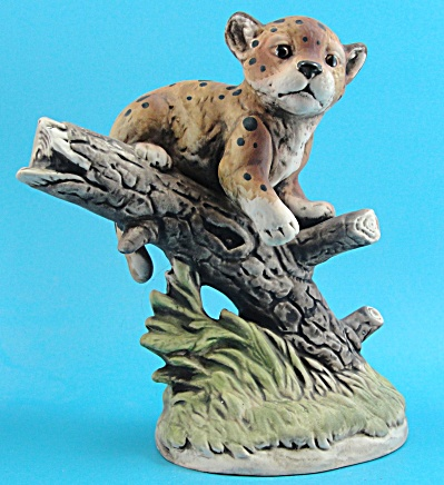 UCTCI Porcelain Leopard Cub on Branch (Image1)