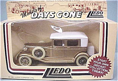 Lledo Days Gone DG19 - Golden Touring Car (Image1)