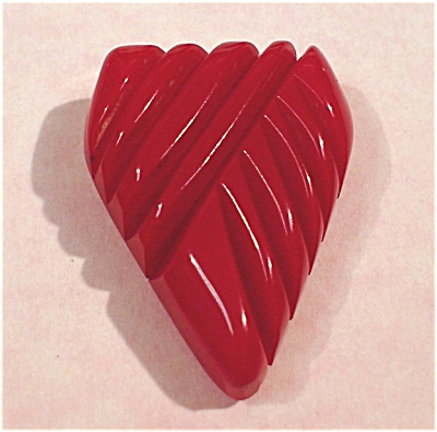 Single Red Carved Bakelite Dress Clip (Image1)