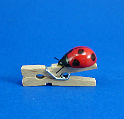 K552 Tiny Porcelain Ladybug On Wood Clothespin