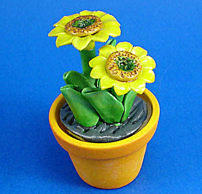 Miniature Flower In Clay Pot