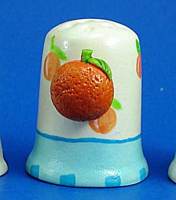 Hand Painted Ceramic Thimble - Orange on Side (Image1)